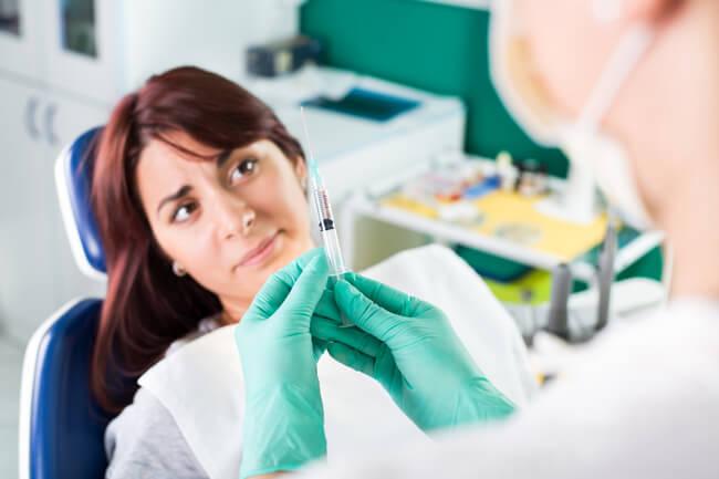 На каком сроке можно лечить зубы во время беременности